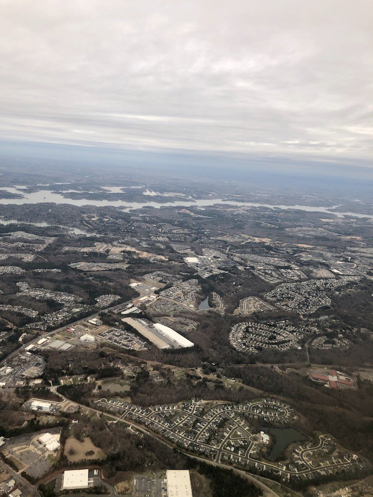 Photo out of a plane window viewing a town - my parents' move took them closer to a major airport