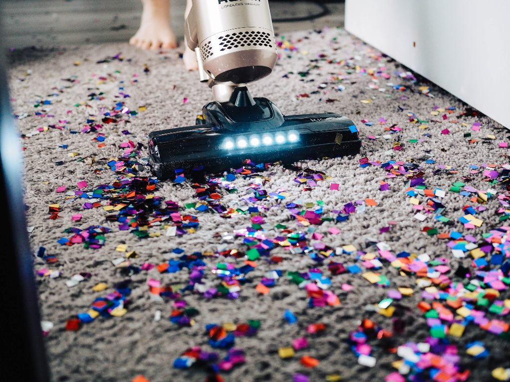 A vacuum cleaning up colorful confetti