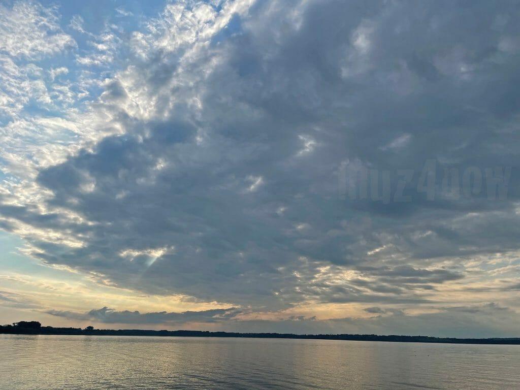 A cloudy sunset over a lake (Seneca Lake)