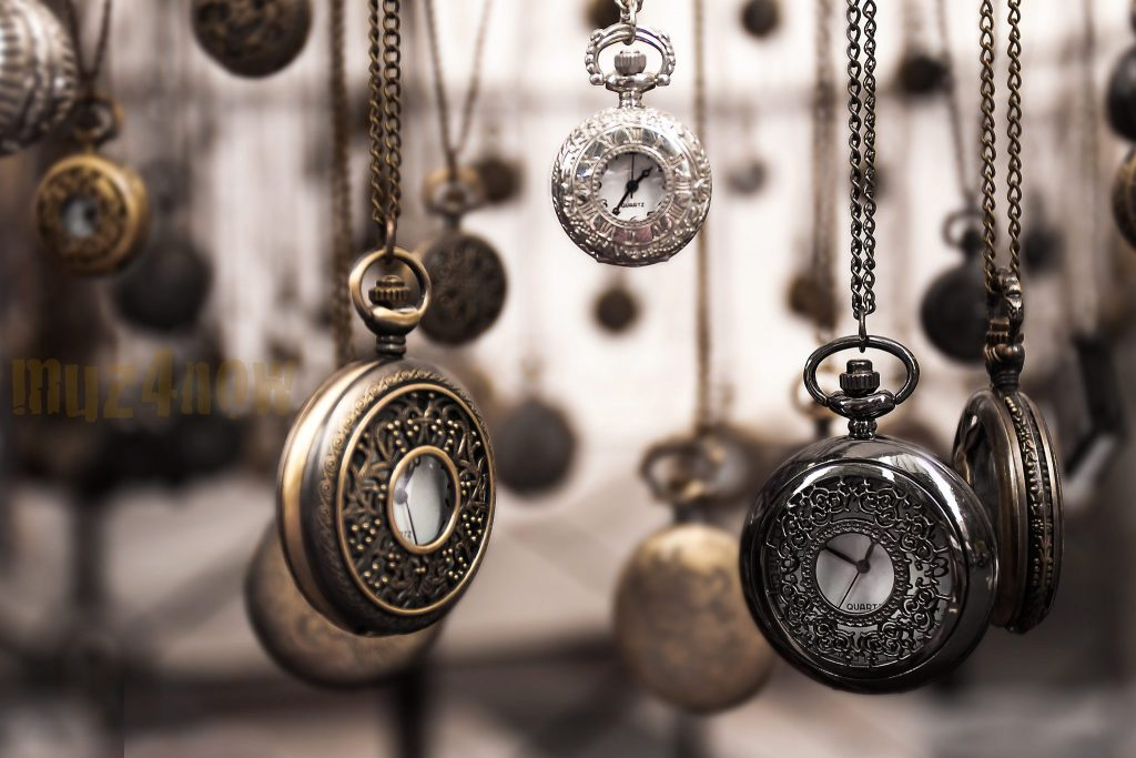 many pocket watches hanging freely in space