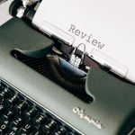 """Typewriter with the word """"review"""" typed on a piece of paper"""