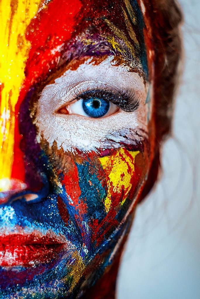 A person's face brightly painted