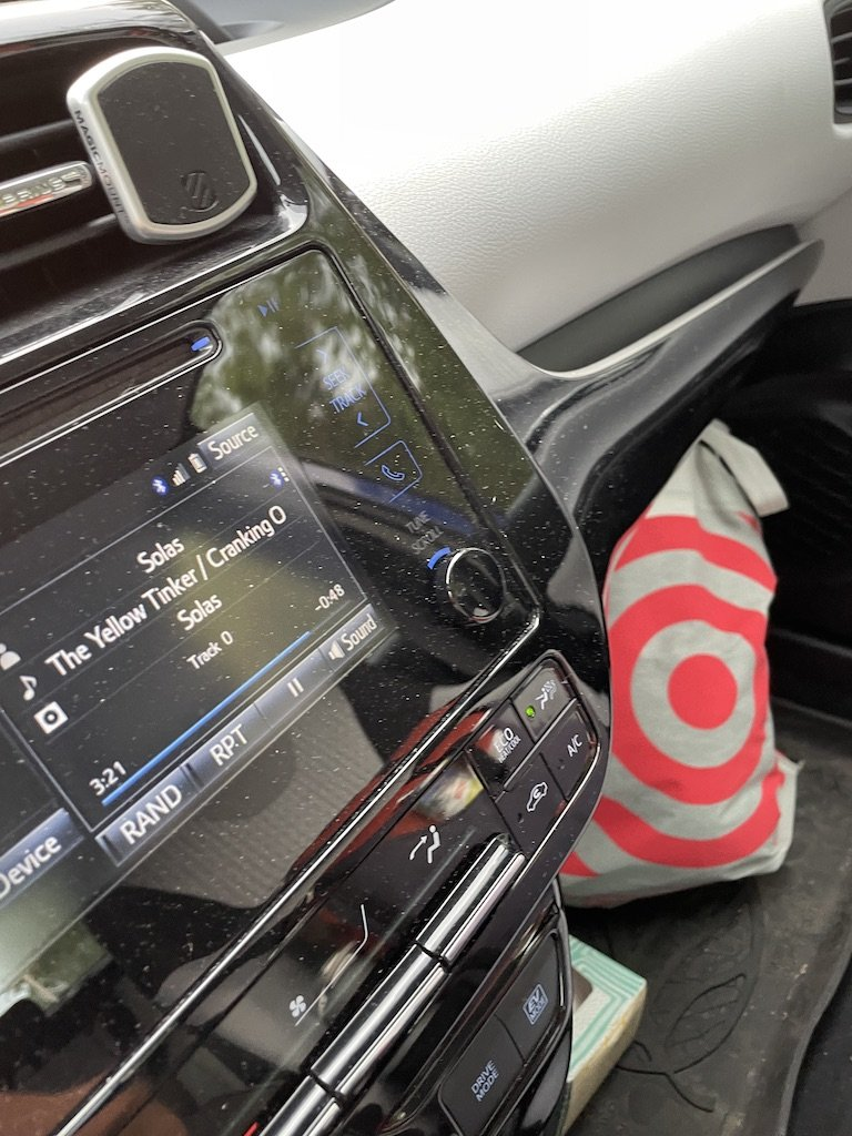 """""""The Yellow Tinker"""" by Solas shows on a car stereo while on a journey"""